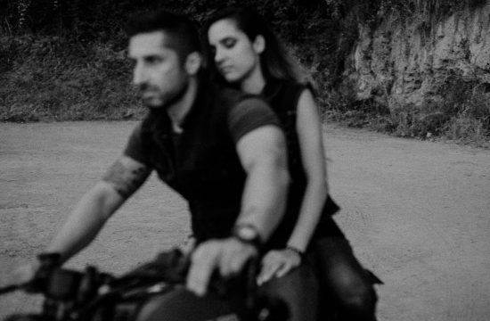 black and white photo of a couple on a motorcycle