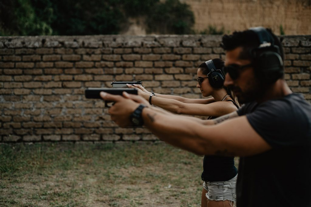couple of future spouses realizes a wedding engagement in a shooting range