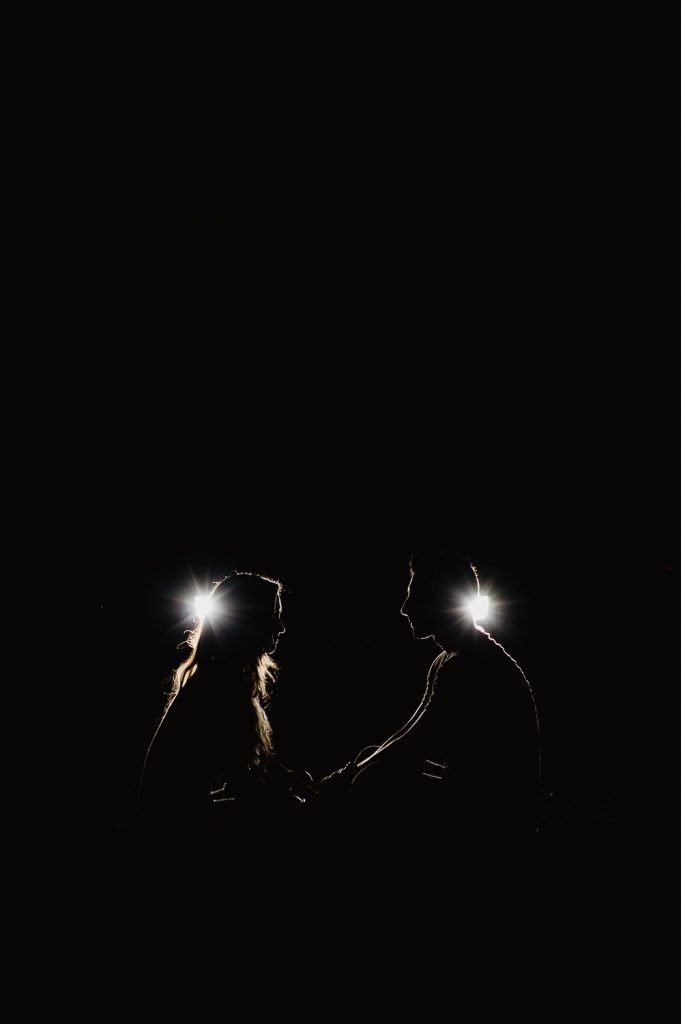 photography couple engagement with car headlights