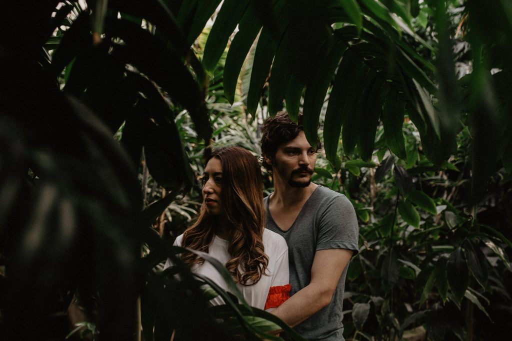 couple engagement inside a greenhouse in Italy