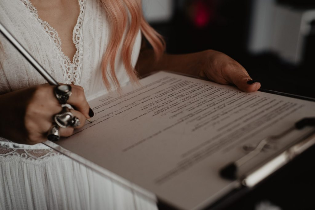 bride filling out a document