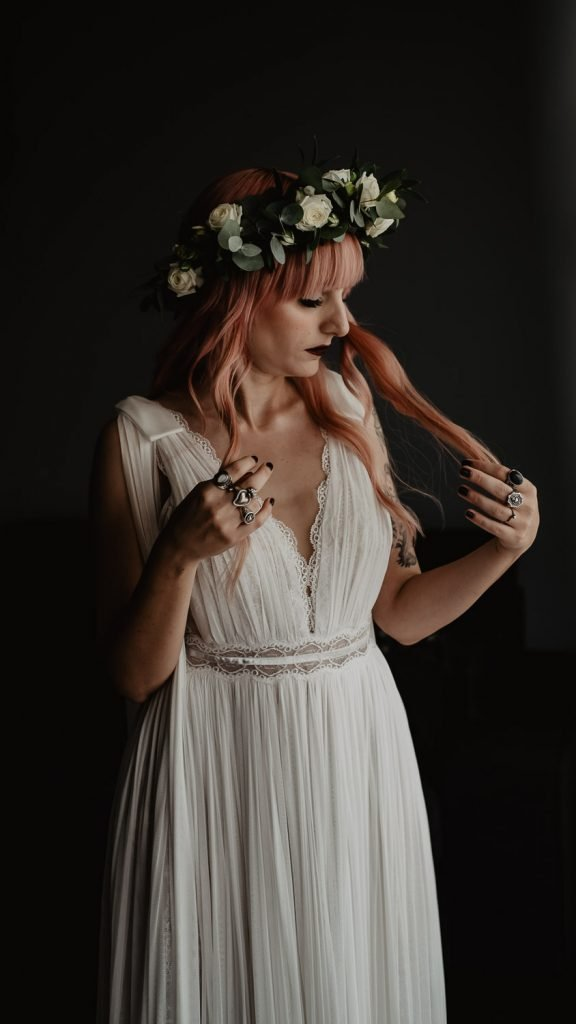 bride photo touching her pink hair