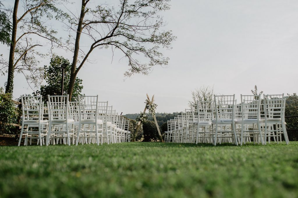 wedding location with lawn and white chairs