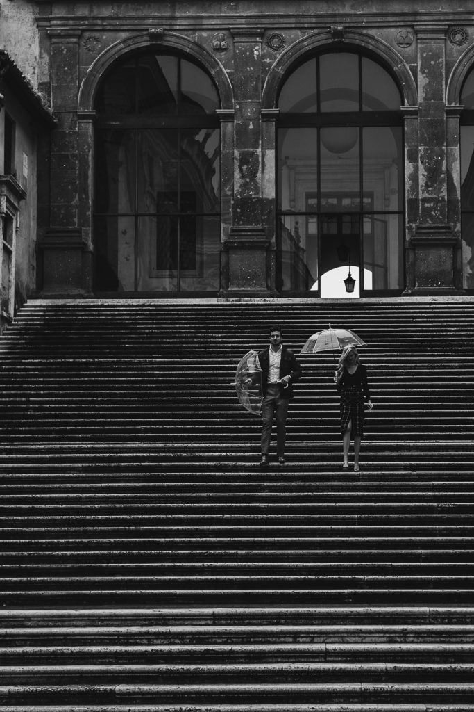 photo of a black and white couple climbing the stairs in Rome