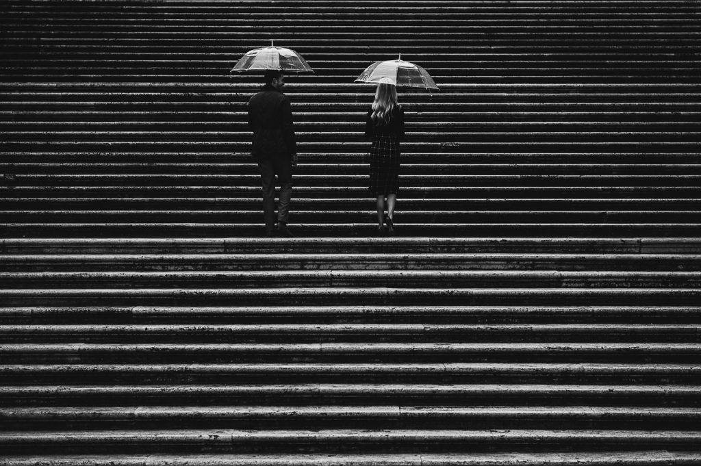 black and white photo of a couple on the stairs of Rome