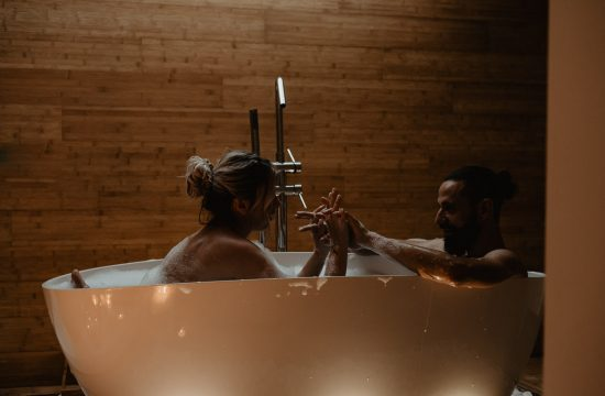 Italian couple making a photo shoot for an engagement in the bathtub