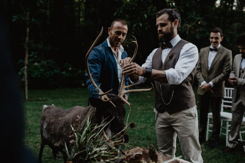 groom and elk with rings during a wedding
