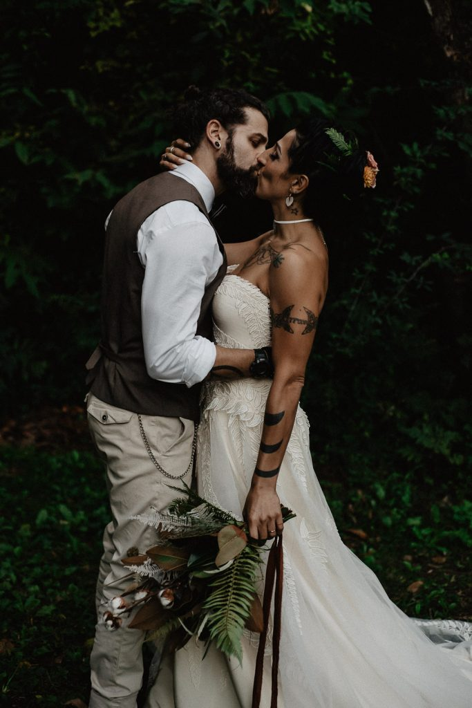 groom and bride kissing each other