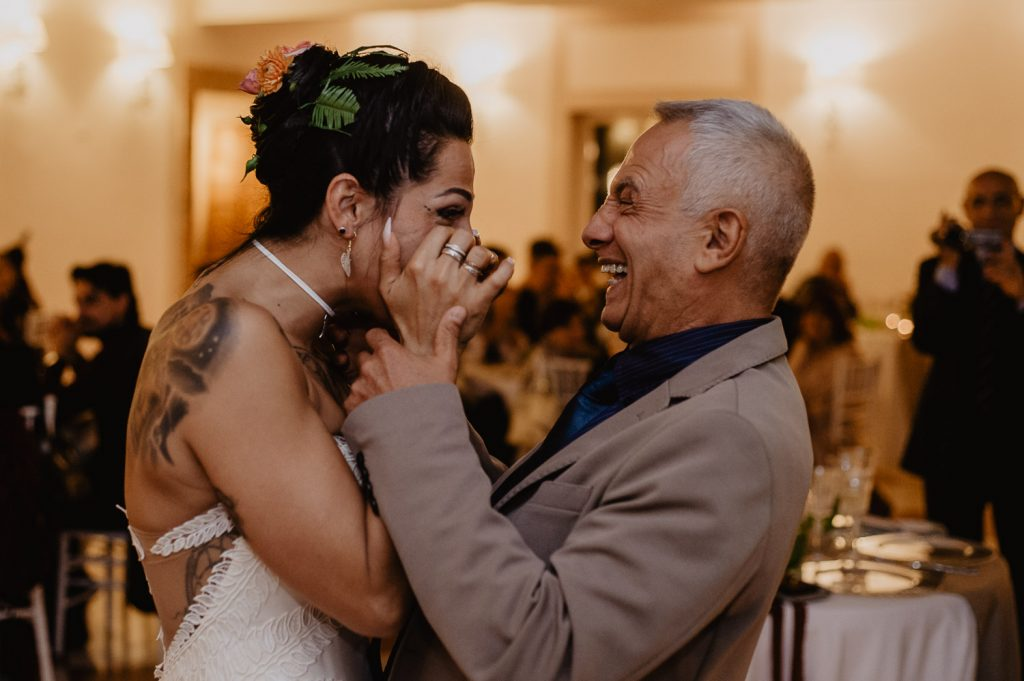 smiling dad makes the bride move