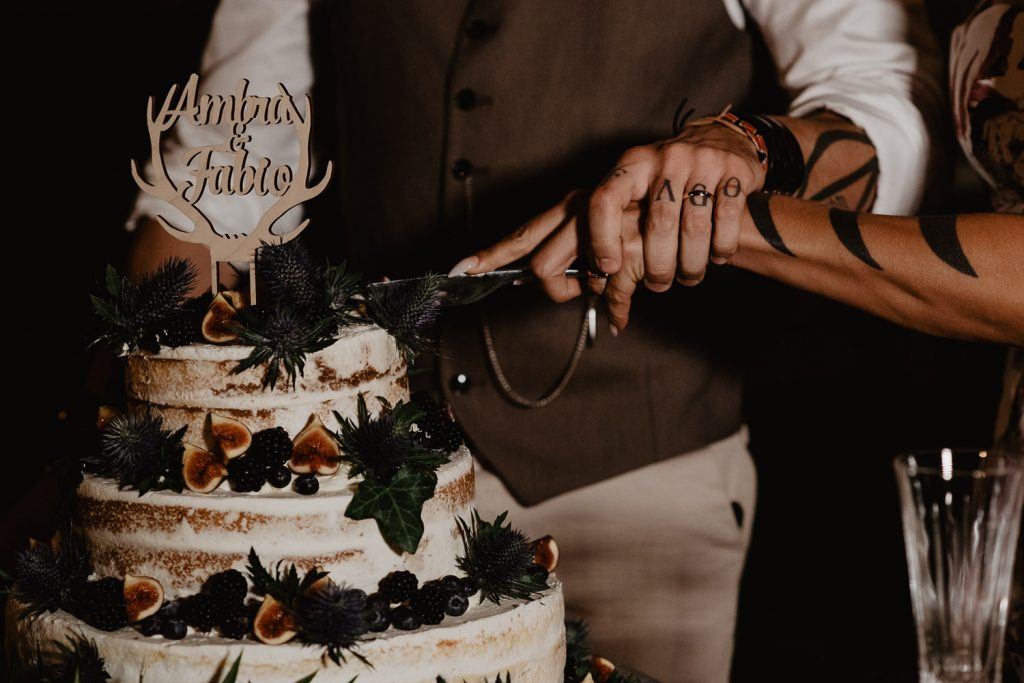 moment of cutting the cake during a wedding