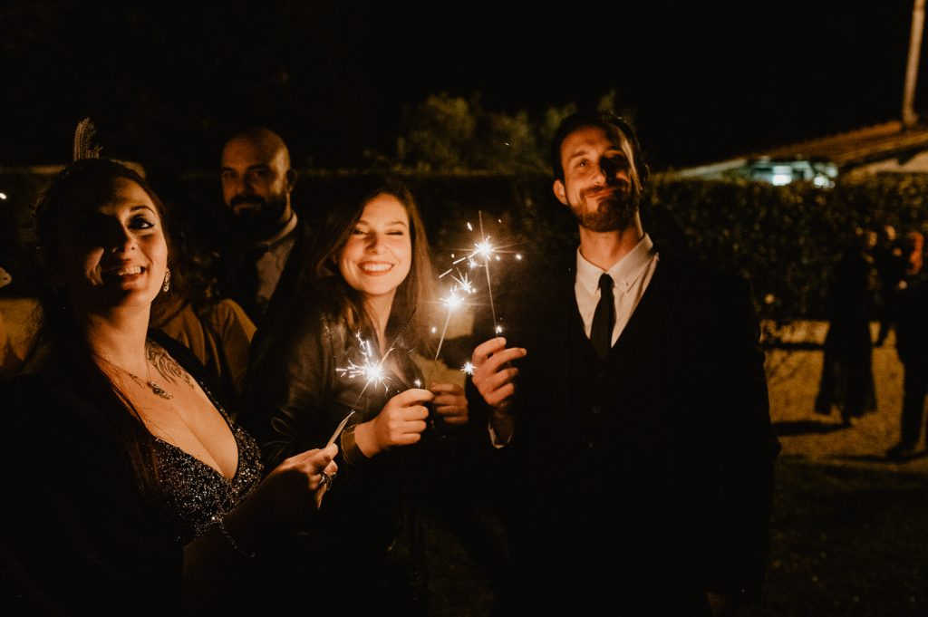 guests use sparkle lights during a wedding